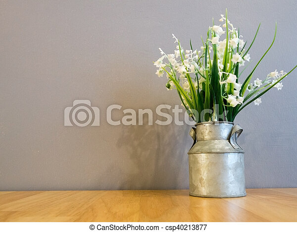 White Spring Flowers In Vintage Galvanized Vase On Wood Table And