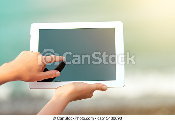 white tablet with a blank screen in the hands - csp15480690