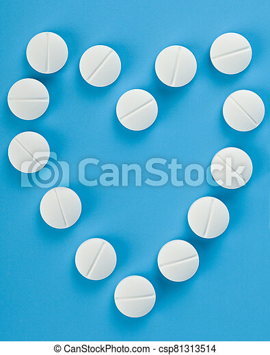 White tablets on a blue background close-up. - csp81313514
