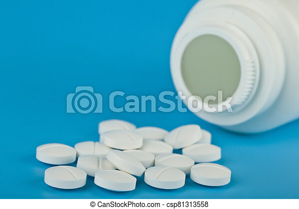 White tablets on a blue background close-up. - csp81313558