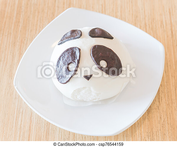 White traditional Chinese panda bear dumpling on desert plate - csp76544159