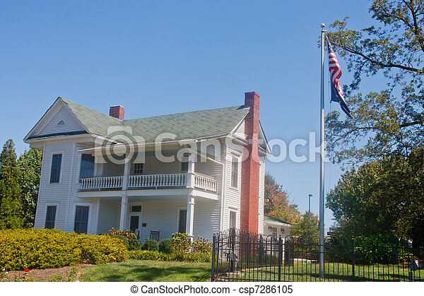 White Two Story Traditional Farm House with Flagpole - csp7286105
