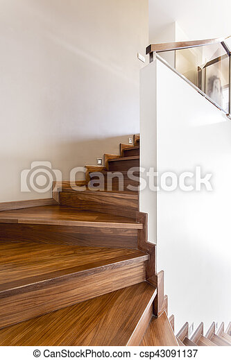 White walls and wooden stairs - csp43091137
