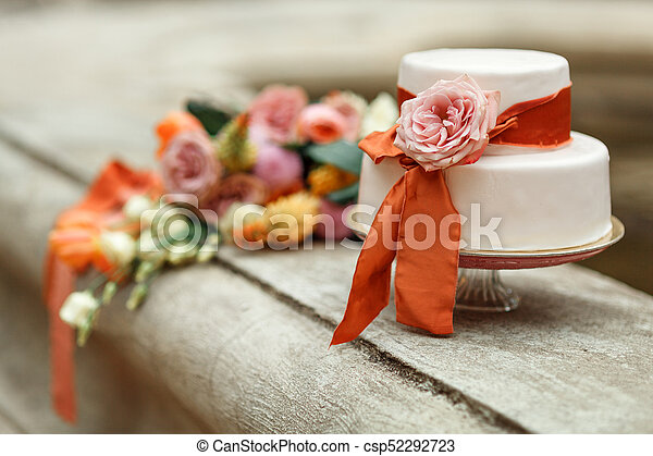 White Wedding Cake With Red Flower On The Background Of A Wedding