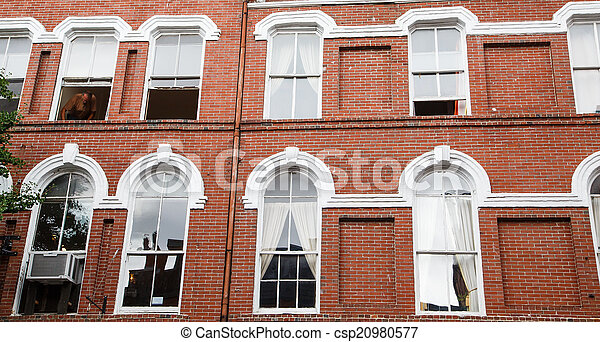 White Windows on Old Red Brick Wall - csp20980577