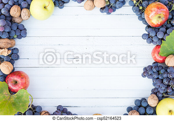 White wood copyspace with autumn fruits frame - csp52164523