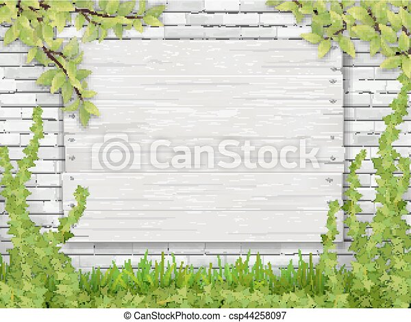 white wooden sign tree branch white brick wall - csp44258097