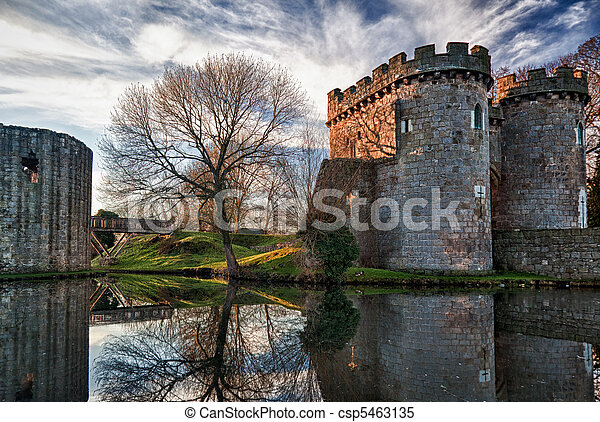 Whittington Castle in Shropshire reflecting on moat - csp5463135
