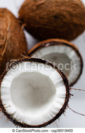 Whole And Broken Coconut On The White Plank Table Stock Photography