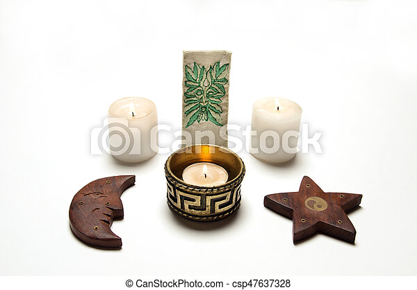 Wiccan altar, candles, pentacle and