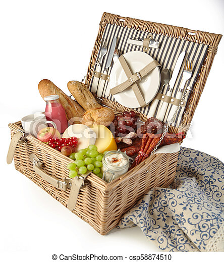 Wicker picnic hamper with assorted fresh food - csp58874510
