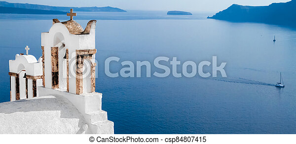 Wide frame view out to sea over the white terrace of Santorini, Cyklade, selective focus - csp84807415