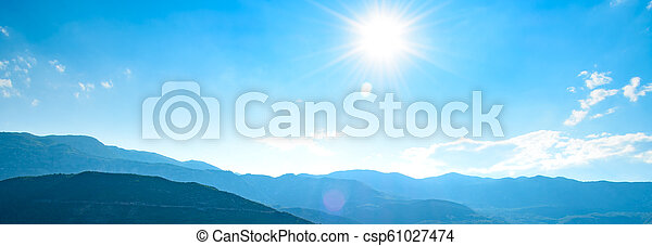 Wide Panorama of Mountains under Bright Sun in the Morning Time - csp61027474