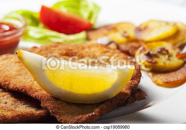 wiener schnitzel with roasted potatoes  - csp19089980