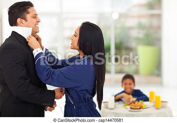 wife helping husband dress - csp14470581