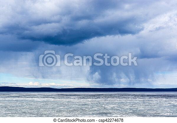 Wild nature cloudy sky and lake - csp42274678