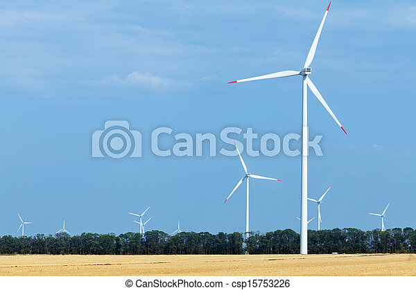 Wind turbine farm above land used for agriculture - csp15753226