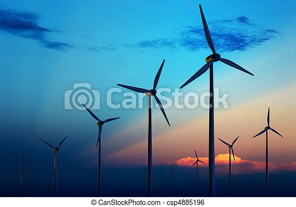 Wind turbine farm at sunset - csp4885196