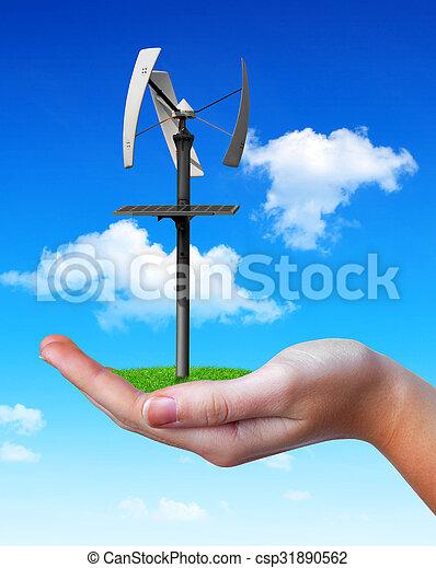 Wind turbine in hand. - csp31890562
