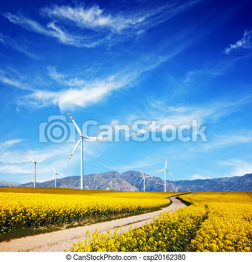 Wind turbines on spring field. Alternative, clean and natural source of energy - csp20162380