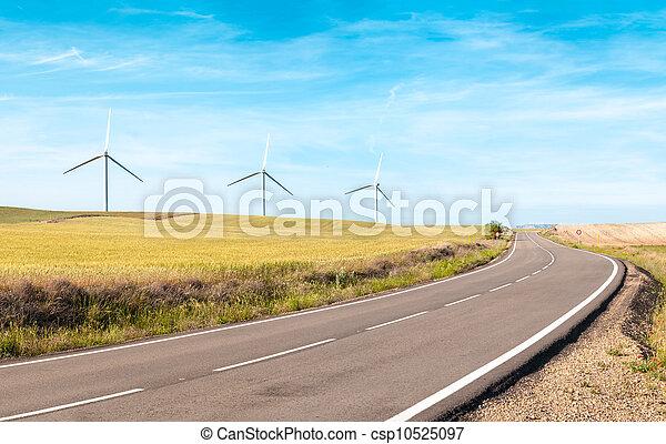 Wind turbines on summer field, green energy. - csp10525097