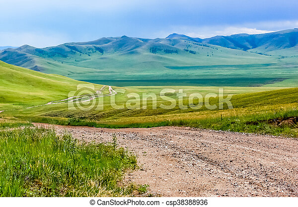 Winding dirt track in Mongolian steppe - csp38388936