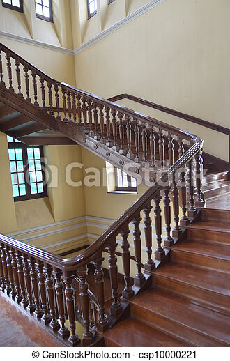 Winding wood staircase in building - csp10000221