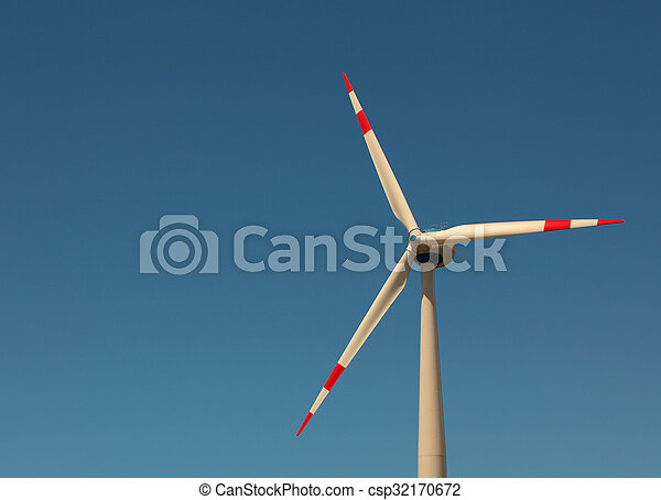 Windmill against bright blue sky - csp32170672