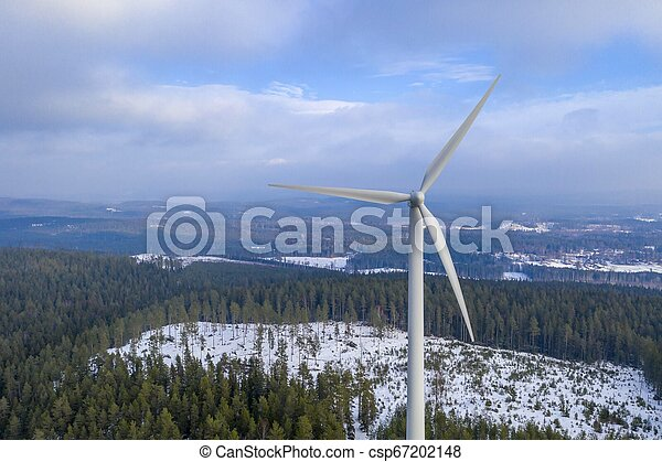Windmill energy in forest drone photo - csp67202148