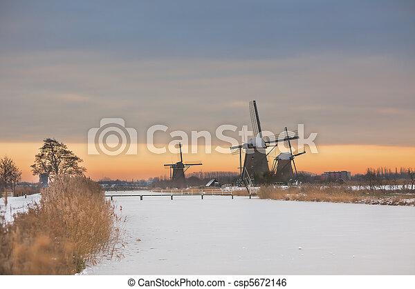 windmills in Kinderdijk at winter sunset - csp5672146