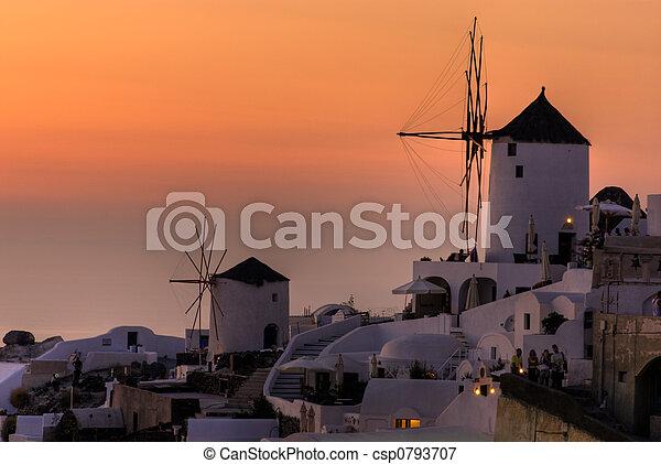 Windmills in sunset - csp0793707