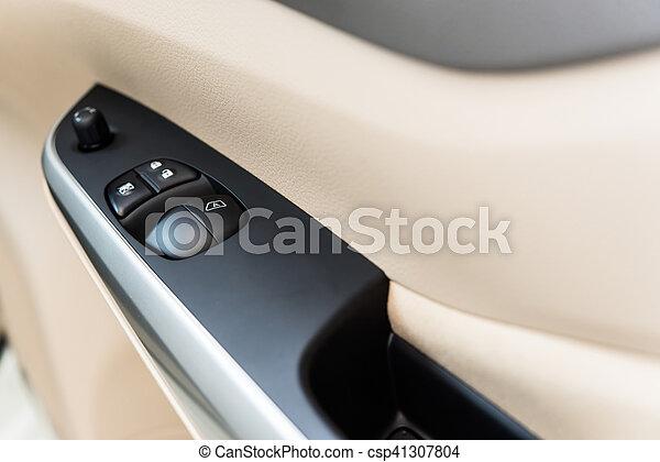 Window and mirror control panel Interior of modern car - csp41307804