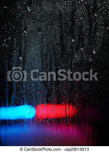 Window and water drops, emergency lights on background - csp29016913