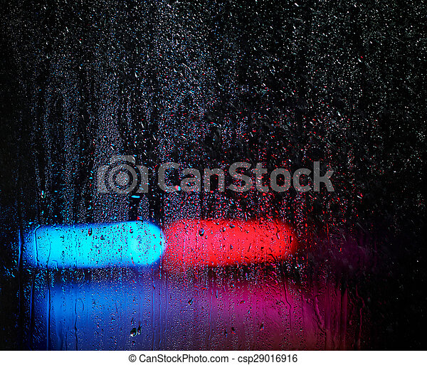 Window and water drops, emergency lights on background - csp29016916