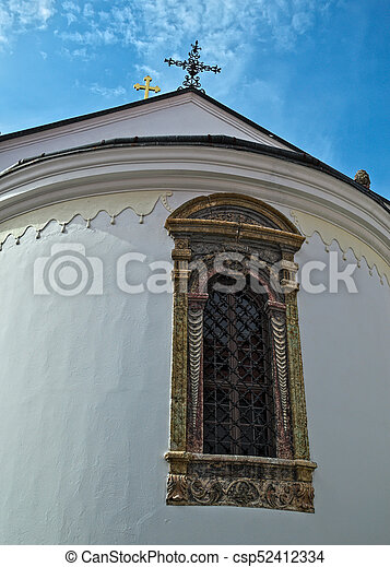 Window on a church at monastery Krusedol in Serbia - csp52412334