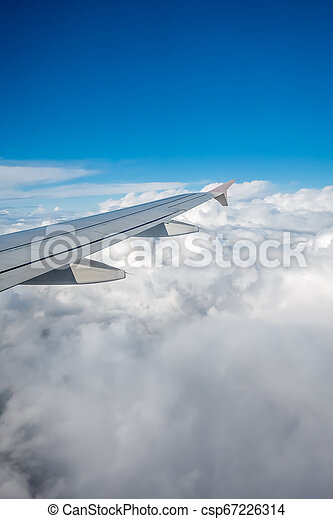 Window view of the wing of an airplane - csp67226314