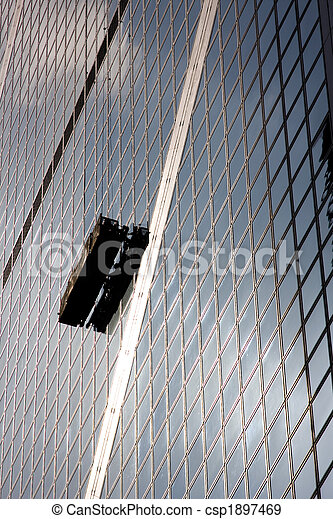 Window Washer on Side of Building - csp1897469