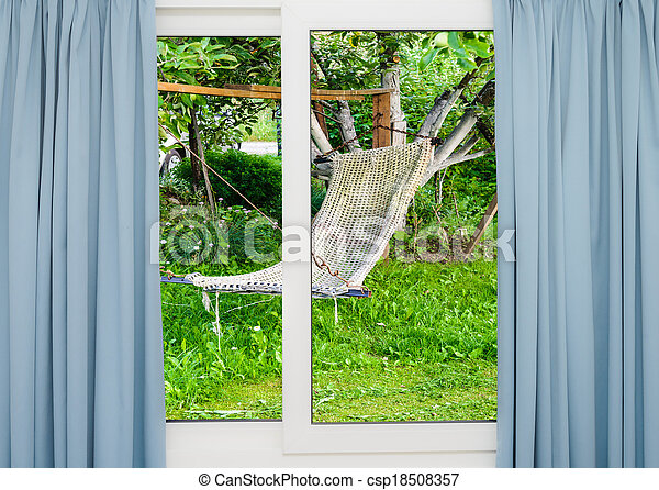 window with curtains overlooking the garden with a hammock - csp18508357