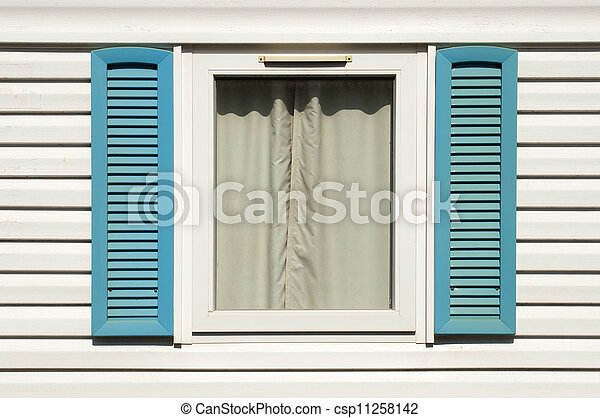 Window with wooden shutters - csp11258142