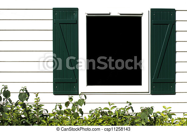 Window with wooden shutters - csp11258143