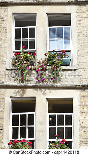 e17b98e8bd48 Windows and flowers. Four sash windows and flower boxes in old house ...