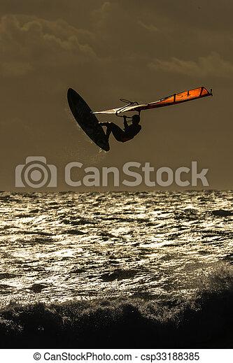 Windsurfer in the evening sun - csp33188385