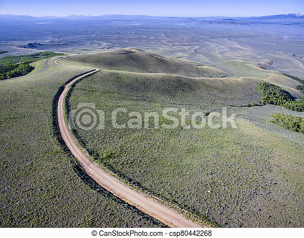 windy back country road aerial view - csp80442268