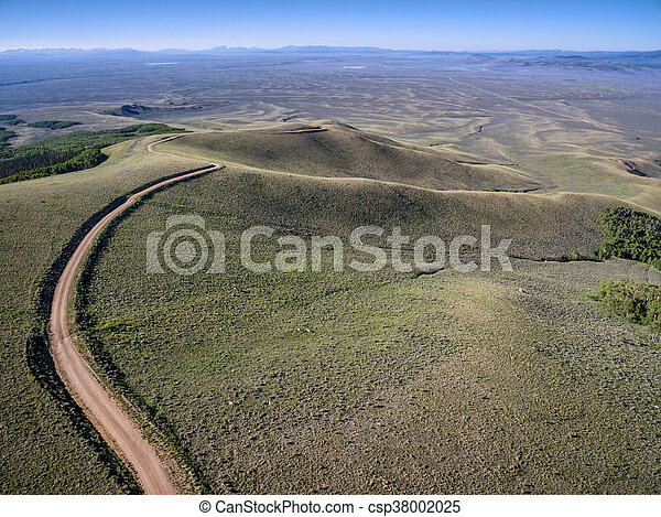 windy back country road aerial view - csp38002025