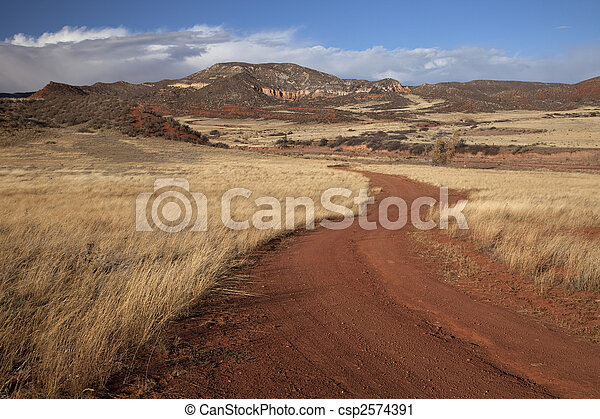 windy ranch road in mountain valley - csp2574391