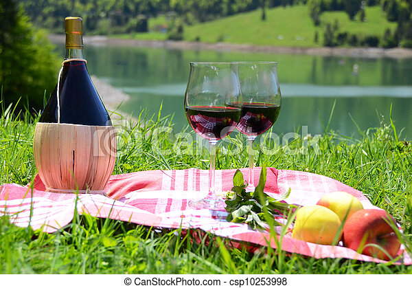 Wine and fruits served at a picnic on Alpine meadow. Switzerland - csp10253998