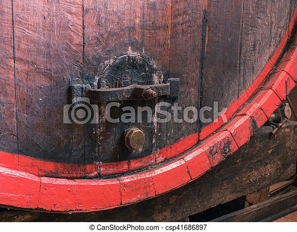 Wine barrel stacked in the old cellar of the winery close up. - csp41686897