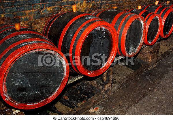 Wine barrels stacked in the old cellar of the winery - csp4694696