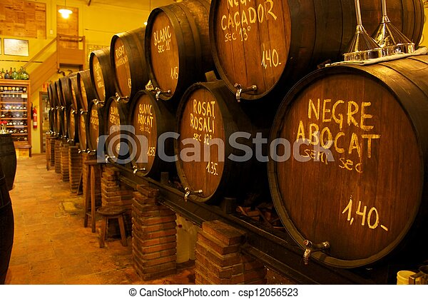 Wine barrels stacked in the old cellar of the winery - csp12056523