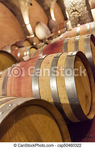 Wine barrels stacked  in the old cellar - csp50460322